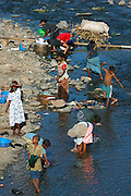 GONDAR/ETHIOPIA..On the road from Gondar to Bahar Dar..Villagers washing at a river..(Photo by Heimo Aga)