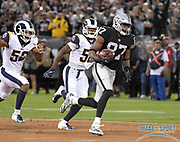 Sep 10, 2018; Oakland, CA, USA; Oakland Raiders tight end Jared Cook (87) is pursued by Los Angeles Rams linebacker Ramik Wilson (52) and linebacker Cory Littleton (58) on a 45-yard reception in the first quarter at the Oakland-Alameda County Coliseum. The Rams defeated the Raiders 33-13.