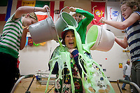 "JEROME A. POLLOS/Press..Dalton Elementary Principal Glenda Armstrong is ""slimed"" by Trisha McCullogh, left, Alexandra Bly and Sierra Kozak during a school assembly Friday. Students were able to duct tape a teacher to a wall, slime the principal and have their facility manager kiss a goat for the students effort in raising $600 for ""Andrea's Closet"" which purchases toys for children undergoing treatment in hospitals."
