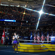 2019 US Open Tennis Tournament- Day Thirteen.    Bianca Andreescu of Canada with the winners trophy after her victory against Serena Williams of the United States in the Women's Singles Final on Arthur Ashe Stadium during the 2019 US Open Tennis Tournament at the USTA Billie Jean King National Tennis Center on September 7th, 2019 in Flushing, Queens, New York City.  (Photo by Tim Clayton/Corbis via Getty Images)<br /> <br /> (Note to editors: A special effects starburst filter was used in the creation of this image)