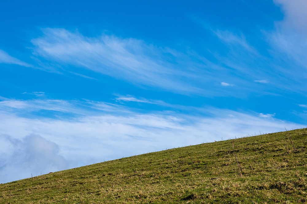 Big blue sky with wispy white cirrus clouds above a steep inclining field on a hill farm Carreg Cennen Castle, Trapp, Brecon Beacons, Powys, UK.  (photo by Andrew Aitchison / In pictures via Getty Images)
