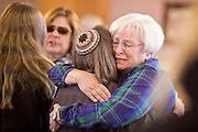 tucsonshooting - 09 JANUARY 2011 - TUCSON, AZ: Rabbi Stephanie Aaron (LEFT) comforts Carole Burtch during a healing service at Congregation Chaverim in Tucson Sunday. Hundreds of people attended the healing service to pray for Congresswoman Gabrielle Giffords and other victims of the mass shooting that took place Saturday.    PHOTO BY JACK KURTZ..RABBI's NAME IS NOT CQ
