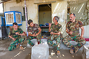 "Peshmerga fighters at the Mount Batiwa frontline share discussion over a morning cup of ""cha"" (tea). Iraqi Kurdistan."