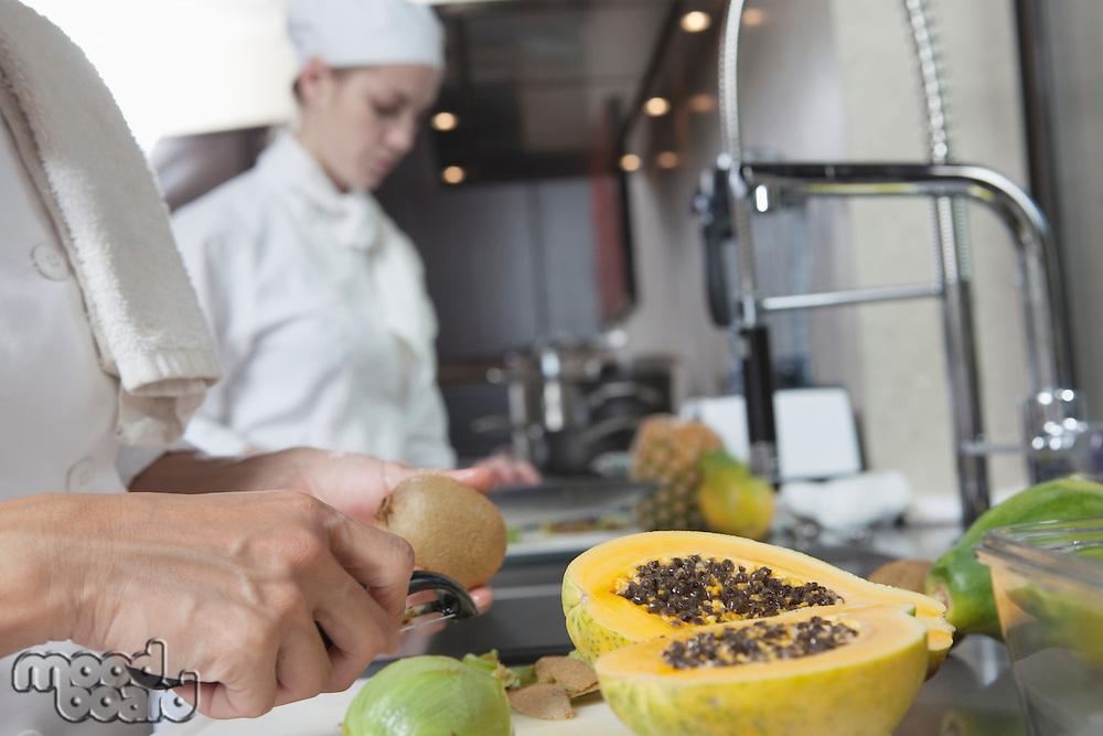 Chef peeling tropical fruit