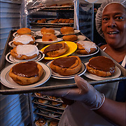 Homeless Soap Kitchen in Atlantic City. Volunteer taking out food. <br /> <br /> The Kitchen was founded by a former casino chef, Jean Webster, 74, found her calling when she saw a man rummaging through a garbage can in search of food.