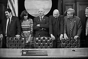 Rep. Doug Isaacson (R), third from right, goofs around as House Representatives squeeze together for a House Majority press conference.