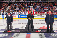 REGINA, SK - MAY 27:  Ken Eskdale of the Royal Canadian Legiona, Brigadier-General Trevor Cadieu of the Canadian Armed Forces and Shaun Semple of the Mastercard Memorial Cup host committee stand at centre ice for the ceremonial puck drop at the Brandt Centre on May 27, 2018 in Regina, Canada. (Photo by Marissa Baecker/CHL Images)