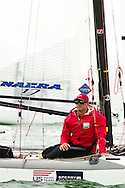 Miami, USA, January 29, 2014 - Nacra 17 tactician John Casey waits with the rest of the fleet for a breeze to fill in at the ISAF Sailing World Cup in Miami.