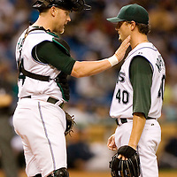 Tampa Bay Devil Rays catcher Toby Hall, left, pats pitcher Doug Waechter on the shoulder as Devil Rays manager Joe Maddon heads to the mound to relive Wachter during the fifth inning of their American League baseball game against the New York Yankees on Thursday, May 4, 2006 in St. Petersburg, Fla.(AP Photo/Scott Audette)