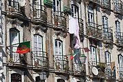 house façade in Lisbon with flags and hang clothes