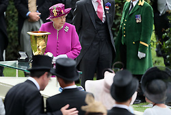 Queen Elizabeth II waits to present the trophy for the Diamond Jubilee Stakes during day five of Royal Ascot at Ascot Racecourse.