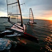 "Dalton Bergan, foreground, and Matt Pistay sails their ""moth"" hydrofoil sailboats on Wednesday November 26, 2008 near Shilshole Bay Marina in Seattle."