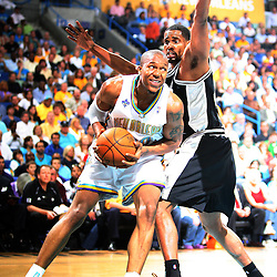 05 May 2008:  Hornets forward David West #30 drives in on Spurs forward Kurt Thomas #40 in the first half of the NBA Playoff Semi-Finals Game 2, a 102-84 victory by the New Orleans Hornets that gave the team a 2-0 series lead over the defending NBA Champion San Antonio Spurs at the New Orleans Arena in New Orleans, LA.