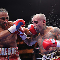 Keith Thurman (L) lands a hook to the face of Luis Collazo during their Premier Boxing Champions boxing match for the WBA Welterweight title on ESPN at the USF Sun Dome, on Saturday, July 11, 2015 in Tampa, Florida.  Thurman won the bout when the corner of Collazo stopped the fight at the beginning of the eighth round. (AP Photo/Alex Menendez)