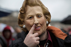 © licensed to London News Pictures. London, UK 13/04/2013. A man posing with Margaret Thatcher mask as a group of people gathering in Trafalgar Square to celebrate the death of former Prime Minister Margaret Thatcher's death on Saturday, 13 April 2013. Photo credit: Tolga Akmen/LNP