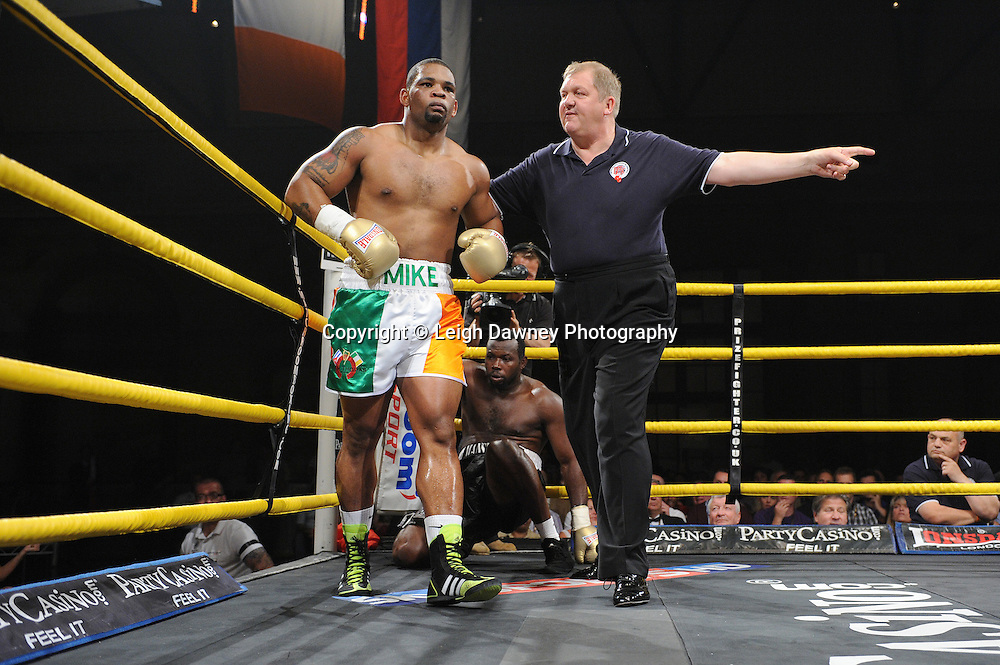 Mike Perez (Irish shorts) knocks down Kerston Manswell in Quarter Final 1 at Prizefighter International and is sent back to a corner on Saturday 7th May 2011. Prizefighter / Matchroom. Photo credit © Leigh Dawney. Alexandra Palace, London.