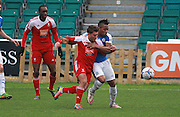 Dover midfielder Aswad Thomas & Whitehawk midfielder Scott Neillson battle for possession during the FA Trophy match between Whitehawk FC and Dover Athletic at the Enclosed Ground, Whitehawk, United Kingdom on 12 December 2015. Photo by Bennett Dean.
