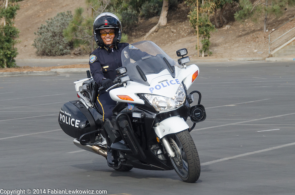 Santa Monica Police Department Chief Jacqueline Seabrooks  rides a motorcycle   at Santa Monica Beach, on Thursday, November 20, 2014.
