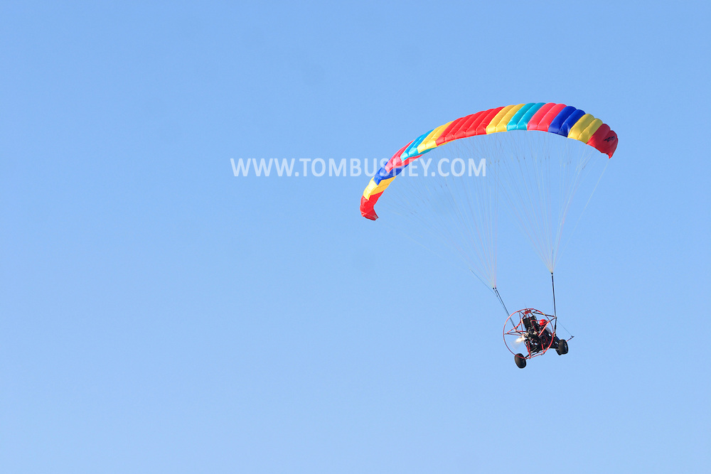 Middletown, NY - An ultralight aircraft takes off into a blue sky from Randall Airport on July 2, 2005.