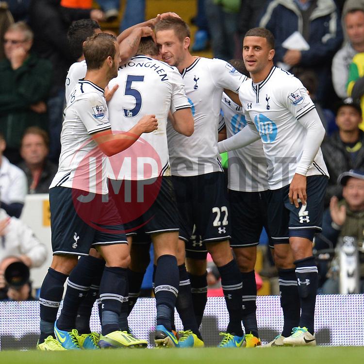 Tottenham's Gylfi Sigurosson celebrates with his team mates after scoring a goal - Photo mandatory by-line: Mitchell Gunn/JMP - Tel: Mobile: 07966 386802 14/09/2013 - SPORT - FOOTBALL -  White Hart Lane - London - Tottenham Hotspur v Norwich - Barclays Premier League