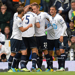 Tottenham's Gylfi Sigurosson celebrates with his team mates after scoring a goal - Photo mandatory by-line: Mitchell Gunn/JMP - Tel: Mobile: 07966 386802 14/09/2013 - SPORT - FOOTBALL -  White Hart Lane - London - Tottenham Hotspur v Norwich - Barclays Premier League