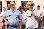 02 APRIL 2006 - THREE POINTS, AZ: TIM MITMAN, left, from Tucson, AZ, DAVID HALVORSON, center, from River Falls, WI and BILL AMES, from Dallas, TX, listen to the briefing before being assigned to observation posts at the Minuteman Project action between Three Points, AZ, and Sasabe, AZ, about 50 miles south of Tucson, AZ, April 2, 2006. Volunteers from the Minuteman Project have set up a line of about 20 observation posts on King's Anvil Ranch, a cattle ranch in the area.  Photo by Jack Kurtz