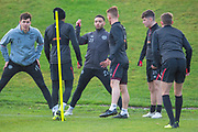 Jake Mulraney (#23) of Heart of Midlothian chats with team mates during training, ahead of the visit of Rangers in the Scottish Premiership on 1st December 2018, at Oriam Sports Performance Centre, Riccarton, Scotland on 30 November 2018.