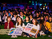 "15 JUNE 2018 - SEOUL, SOUTH KOREA:  South Koreans listen to speakers during a rally to mark the anniversary of the signing of the June 15th North–South Joint Declaration between South Korea and North Korea. The Declaration was negotiated by late South Korean President Kim Dae-jung and North Korean leader Kim Jong-il and signed on 15 June 2000. It was a part of South Korea's ""Sunshine Policy,"" which guides the South's relationship with North Korea. This year's observance of the anniversary was bolstered by the recent thawing in relations between North Korea and South Korea and the US.     PHOTO BY JACK KURTZ"
