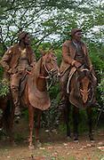 Brazilian 'Vaquieros' Cowboys<br /> Caatinga Habitat<br /> Piaui State, NE BRAZIL.  South America<br /> <br /> Fully leather clad against harsh spines of Caatinga Vegetation.