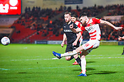 Ben Whiteman of Doncaster Rovers (8) clears the ball during the EFL Sky Bet League 1 match between Doncaster Rovers and Barnsley at the Keepmoat Stadium, Doncaster, England on 15 March 2019.