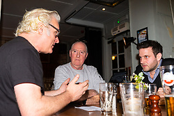 Paul Greendale, left, a remain-voting musician and producer discusses Brexit with Philip Davenport, second left, a construction worker and ardent brexiteer discuss Brexit with Bild Reporter Philip Fabian at the Whippet Inn in North West London . London January 13 2019.