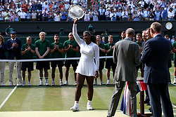 Serena Williams with her runners up trophy on day twelve of the Wimbledon Championships at the All England Lawn Tennis and Croquet Club, Wimbledon. PRESS ASSOCIATION Photo. Picture date: Saturday July 14, 2018. See PA story TENNIS Wimbledon. Photo credit should read: Jonathan Brady/PA Wire. RESTRICTIONS: Editorial use only. No commercial use without prior written consent of the AELTC. Still image use only - no moving images to emulate broadcast. No superimposing or removal of sponsor/ad logos. Call +44 (0)1158 447447 for further information.