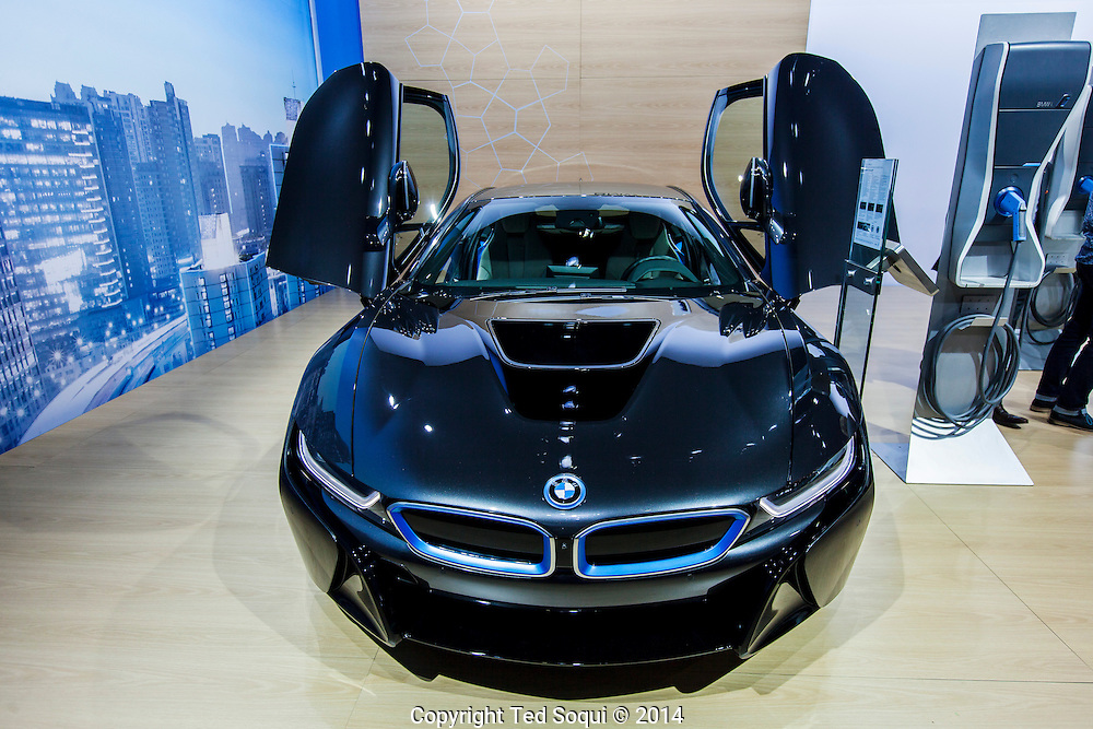 The 2014 Los Angeles Auto Show at the Los Angeles Convention Center.<br /> 2014 BMW i8. This car cost $136550 USD. It has two motors, one 3 cyl. gas motor and one electric engine.