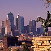 Missouri, Kansas City; Native American 'Scout' Monument And City Skyline At Sunset