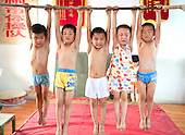 Children Put through Extreme Gymnastics Training Session