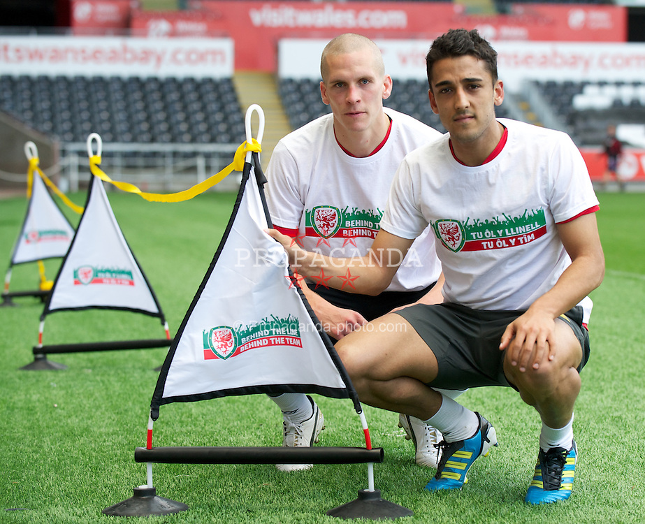 """SWANSEA, WALES - Friday, October 7, 2011: Wales' Steve Morison and Neil Taylor lend their support to the """"Behind the Line - Behind the Team"""" campaign  at the Liberty Stadium. (Pic by David Rawcliffe/Propaganda)"""
