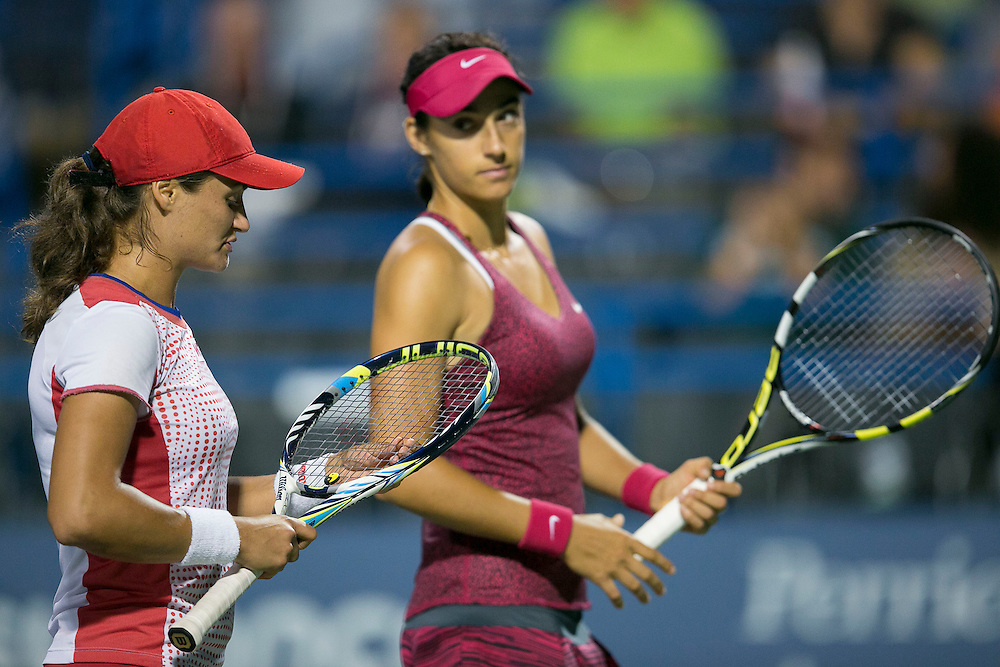 August 22, 2014, New Haven, CT:<br /> Caroline Garcia chats with Monica Niculescu during the women's doubles semi-finals against Marina Erakovic and Arantxa Parra Santonja on day eight of the 2014 Connecticut Open at the Yale University Tennis Center in New Haven, Connecticut Friday, August 22, 2014.<br /> (Photo by Billie Weiss/Connecticut Open)
