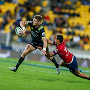 Beauden Barrett passes during the Super rugby union game (Round 14) played between Hurricanes v Reds, on 18 May 2018, at Westpac Stadium, Wellington, New  Zealand.    Hurricanes won 38-34.