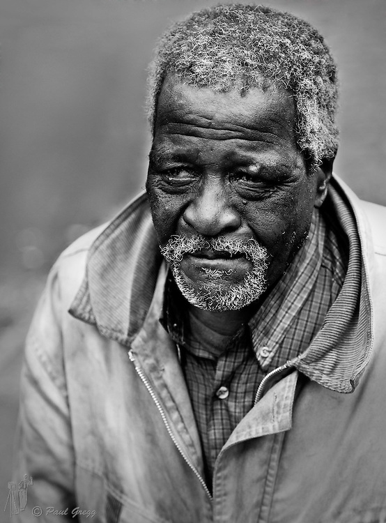 An old African man living on the streets of Durban by Paul Gregg a Durban portrait photographer. A series of street people images by Durban photographer Paul Gregg for Imagemakers.