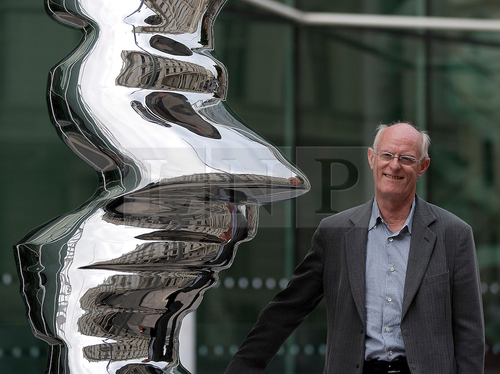 © Licensed to London News Pictures. 24/08/2012. LONDON, UK. British sculptor Tony Cragg is stands with a piece of his work entitled 'Elliptical Column 2012'. The piece, one of five on display along the recently pedestrianised Exhibition Road, forms part of an open air exhibition called Tony Cragg at Exhibition Road,. Photo credit: Matt Cetti-Roberts/LNP