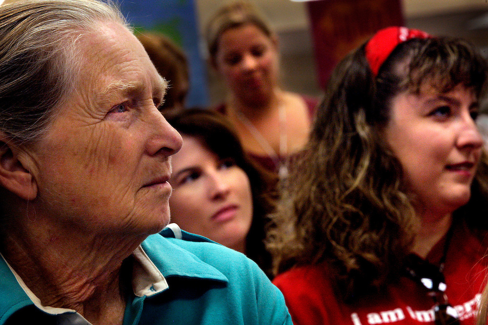 Katherine Smith, 71, left, listens among other Golden Gate Estates parents during an orientation meeting at Sable Palm Elementary School, the new school her great-grandsons will attend in the fall because of the changing bus routes. Greg Kahn/Staff
