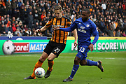 Hull City defender Michael Dawson (21) and Cardiff City midfielder Junior Hoilett (33) battles for possession during the EFL Sky Bet Championship match between Hull City and Cardiff City at the KCOM Stadium, Kingston upon Hull, England on 28 April 2018. Picture by Mick Atkins.