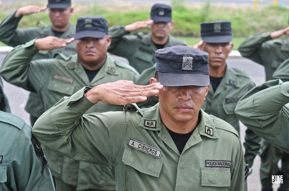 Uniformed officials perform a military hand salutation. Panamanian National Police forces.    Panama. - July 11, 2012 (Kike Calvo via AP Images)