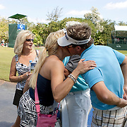 PGA Tour player Brian Gay greets his wife, Kimberly, at the end of a round at the Mayakoba Classic in Riviera Maya, Mexico.