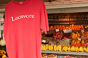 "A hanging T-shirt imprinted with the word ""Locavore"" at Walker's Roadside Stand, Little Compton, Rhode Island."