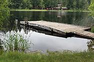 Swimming and fishing dock (with Cusheon Lake Resort in the background) on Cusheon Lake at the Cusheon Lake Public Viewpoint along Cusheon Lake Road, Salt Spring Island, British Columbia, Canada