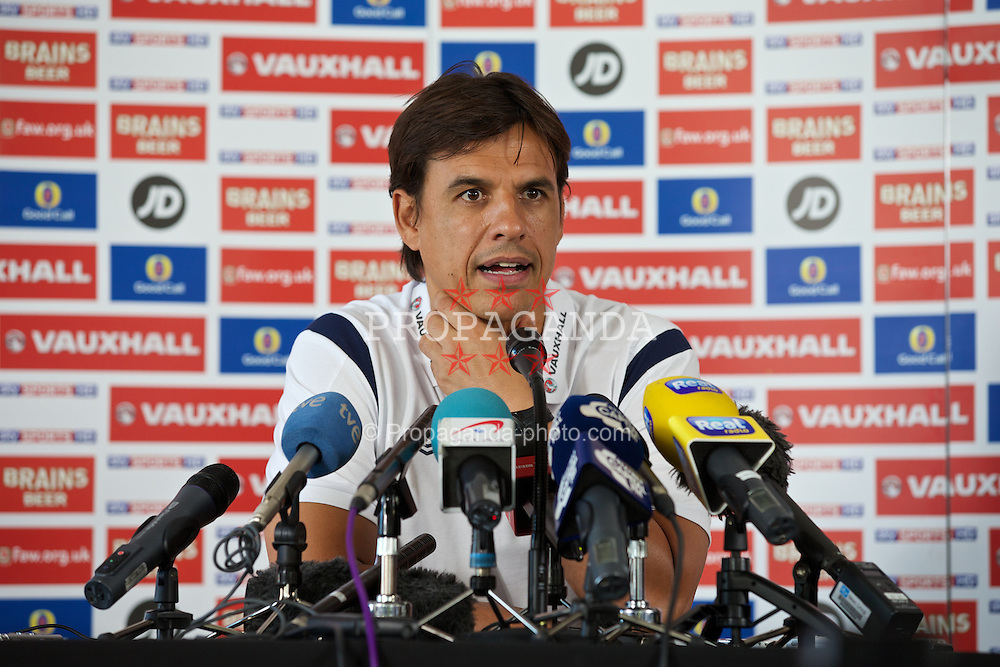 CARDIFF, WALES - Tuesday, September 3, 2013: Wales' manager Chris Coleman during a press conference at the St. David's Hotel ahead of the 2014 FIFA World Cup Brazil Qualifying Group A match against Macedonia. (Pic by David Rawcliffe/Propaganda)