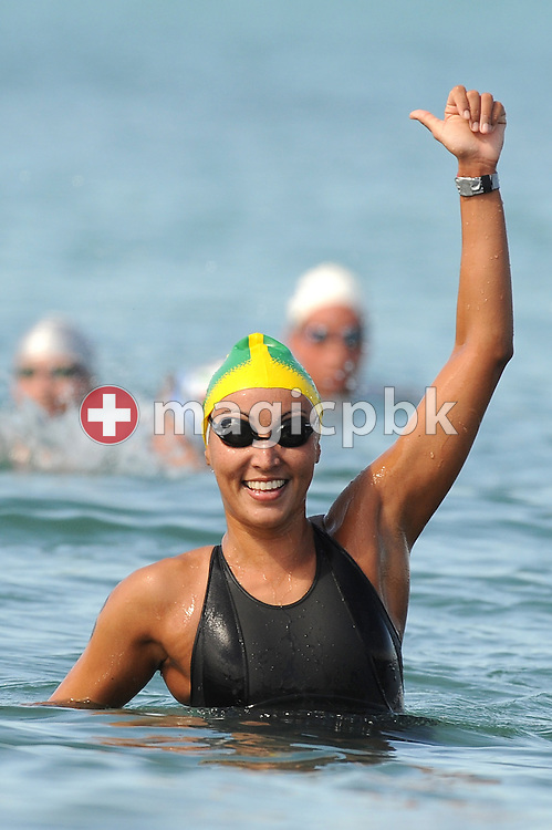 Third placed Poliana Okimoto of Brazil jubilates after competing in the women's 5km open water swimming at the 13th FINA World Championships at the beach in Ostia near Rome, Italy, Tuesday, July 21, 2009. (Photo by Patrick B. Kraemer / MAGICPBK)