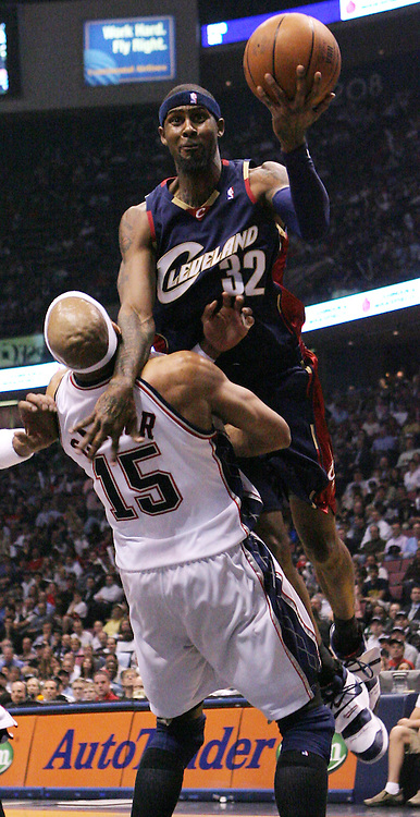 The Cavaliers' Larry Hughes  (R) drives into the Nets' Vince Carter  (L)during the first half of game 4 of the Eastern conference semifinals between the Cleveland Cavaliers and the New Jersey Nets at Continental Airlines Arena in East Rutherford, New Jersey on 14 May 2007.