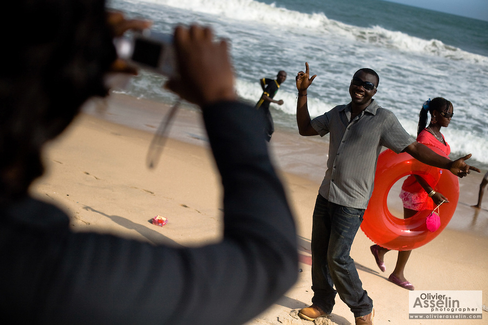 Doris Morrison Amankwaa takes pictures of her boyfriend Emmanuel Kwaku Yeboah on the beach in Cape Coast, Ghana on Sunday September 7, 2008. The couple was visiting to attend the Oguaa Fetu Afahye Festival, held annually in the coastal town.